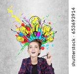 close up of a geeky teen girl... | Shutterstock . vector #653693914