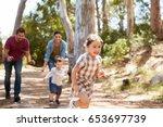 Family Running Along Path...