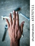 Small photo of Dirty black hands may have pathogens that affect health