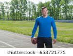 young american football player... | Shutterstock . vector #653721775