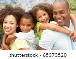 portrait of happy family in park | Shutterstock . vector #65373520
