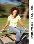 young woman riding on... | Shutterstock . vector #65373586