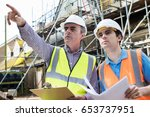 architect and builder... | Shutterstock . vector #653737951