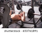 man in the gym lifting heavy