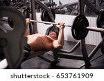 man in the gym lifting heavy... | Shutterstock . vector #653761909