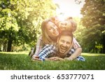 happy family enjoying together... | Shutterstock . vector #653777071