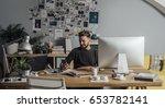 young cool designer working in...   Shutterstock . vector #653782141