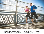 couple running in brooklyn.... | Shutterstock . vector #653782195