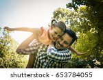 single father on meadow with... | Shutterstock . vector #653784055