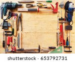 various tools on a wooden table | Shutterstock . vector #653792731