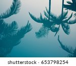 palm tree reflection in water.  | Shutterstock . vector #653798254