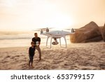 drone being operated by father... | Shutterstock . vector #653799157