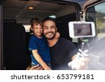 handsome young dad and his cute ... | Shutterstock . vector #653799181