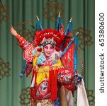 "BEIJING-FEBRUARY 19: Actors of China National Peking Opera Company perform the Peking Opera ""The Red Haired Galloping Horse"" at Meilanfang theatre on February 19, 2010 in Beijing, China - stock photo"