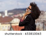 black businesswoman talking on... | Shutterstock . vector #653810065