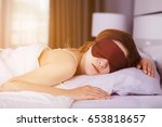 woman sleeping on bed with eye... | Shutterstock . vector #653818657