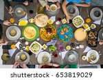 table of enjoying food with... | Shutterstock . vector #653819029