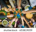 table of enjoying food with... | Shutterstock . vector #653819059