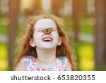 funny laughing curly girl with... | Shutterstock . vector #653820355