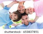 happy family outdoors  | Shutterstock . vector #653837851