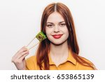 woman holding sushi  woman with ... | Shutterstock . vector #653865139