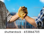 handshake against city... | Shutterstock . vector #653866705