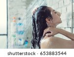 asian women bathing and she was ... | Shutterstock . vector #653883544