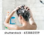 asian women bathing and she was ... | Shutterstock . vector #653883559