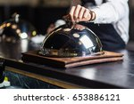 attractive young waiter in... | Shutterstock . vector #653886121