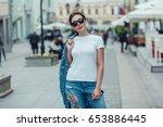 attractive girl in sunglasses... | Shutterstock . vector #653886445