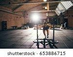 sportive woman pushing bogie in ... | Shutterstock . vector #653886715
