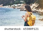 hipster girl with backpack hold ... | Shutterstock . vector #653889121