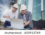 view of workers and architects... | Shutterstock . vector #653913769