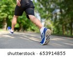 young man jogging. | Shutterstock . vector #653914855