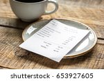 coffee and check on cafe wooden ... | Shutterstock . vector #653927605