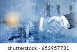 double exposure hand shake of... | Shutterstock . vector #653957731
