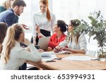 business people analyzing... | Shutterstock . vector #653994931