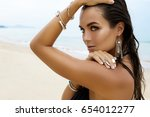 beautiful and sexy woman on the ... | Shutterstock . vector #654012277