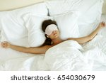woman is wearing eye mask and... | Shutterstock . vector #654030679