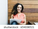 mixed race student looking at... | Shutterstock . vector #654038521