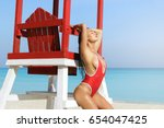 sexy woman  in red swimsuit... | Shutterstock . vector #654047425