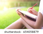 female hands with pencil... | Shutterstock . vector #654058879