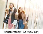 friends are happy shopping ... | Shutterstock . vector #654059134