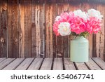 pink and white peonies in a...   Shutterstock . vector #654067741