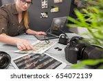 Small photo of photographer journalist camera traveling photo dslr editing edit hobbies lighting business designer concept - stock image
