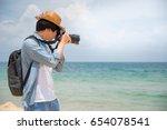 Young Asian Man Photographer...