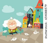 old man feeding pigeons | Shutterstock .eps vector #654088579