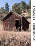 Old Mining Cabin in Mountains of Colorado - stock photo