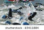 triathlon swimmers churning up... | Shutterstock . vector #65411884