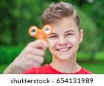 young teen boy holding popular... | Shutterstock . vector #654131989